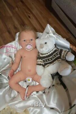 Solid silicone all body baby girl (reborn doll) Drink & wets diaper Glass eyes